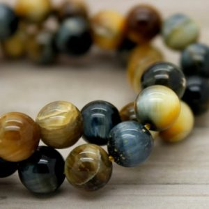 Shop Tiger Eye Beads! Blue Gold Tiger's Eye Round Smooth Natural Loose Gemstone Beads (6mm, 8mm, 10mm) | Natural genuine beads Tiger Eye beads for beading and jewelry making.  #jewelry #beads #beadedjewelry #diyjewelry #jewelrymaking #beadstore #beading #affiliate #ad