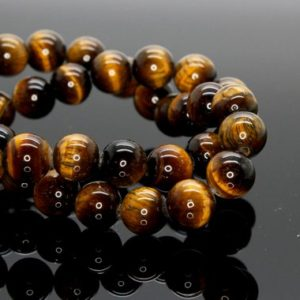 Shop Tiger Eye Round Beads! Tiger Tiger's Eye Smooth Round Gemstone 4mm 6mm 8mm 10mm Beads (full Strand) | Natural genuine round Tiger Eye beads for beading and jewelry making.  #jewelry #beads #beadedjewelry #diyjewelry #jewelrymaking #beadstore #beading #affiliate #ad