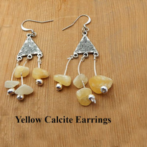 Shop Calcite Earrings! Yellow Calcite Earrings.  Yellow calcite chips hung from a silver triangle. Drop earrings.  Gift for her.  Birthday gift.  Friendship gift. | Natural genuine Calcite earrings. Buy crystal jewelry, handmade handcrafted artisan jewelry for women.  Unique handmade gift ideas. #jewelry #beadedearrings #beadedjewelry #gift #shopping #handmadejewelry #fashion #style #product #earrings #affiliate #ad