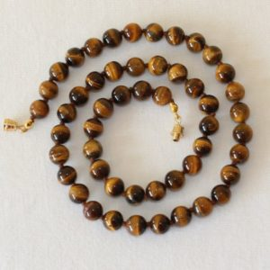 Shop Tiger Eye Jewelry! 8mm Tiger Eye Necklace – VARIOUS Length Options Hand Knotted. Brown Tiger Eye / Tiger's Eye Stone. Therapeutic. MapenziGems | Natural genuine Tiger Eye jewelry. Buy crystal jewelry, handmade handcrafted artisan jewelry for women.  Unique handmade gift ideas. #jewelry #beadedjewelry #beadedjewelry #gift #shopping #handmadejewelry #fashion #style #product #jewelry #affiliate #ad