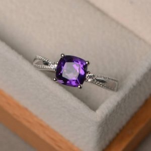 Shop Amethyst Engagement Rings! Engagement ring, natural purple amethyst ring, cushion cut gemstone, February birthstone, gifts for her | Natural genuine Amethyst rings, simple unique alternative gemstone engagement rings. #rings #jewelry #bridal #wedding #jewelryaccessories #engagementrings #weddingideas #affiliate #ad