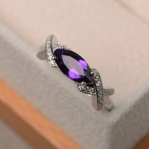 Shop Unique Amethyst Engagement Rings! Engagement ring, natural purple amethyst ring, marquise cut gemstone, February birthstone, sterling silver ring | Natural genuine Amethyst rings, simple unique alternative gemstone engagement rings. #rings #jewelry #bridal #wedding #jewelryaccessories #engagementrings #weddingideas #affiliate #ad