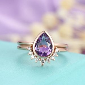 Shop Unique Amethyst Engagement Rings! Amethyst engagement ring set Vintage Pear shaped ring set rose Gold Curved wedding band set art deco Bridal ring set Anniversary ring set | Natural genuine Amethyst rings, simple unique alternative gemstone engagement rings. #rings #jewelry #bridal #wedding #jewelryaccessories #engagementrings #weddingideas #affiliate #ad