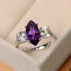 Shop Amethyst Engagement Rings! Amethyst ring, marquise cut amethyst , engagement ring, purple amethyst, three stone ring | Natural genuine Amethyst rings, simple unique alternative gemstone engagement rings. #rings #jewelry #bridal #wedding #jewelryaccessories #engagementrings #weddingideas #affiliate #ad