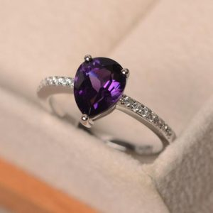 Shop Amethyst Engagement Rings! Natural amethyst ring, pear cut purple gemstone, sterling silver, February birthstone, engagement ring for women | Natural genuine Amethyst rings, simple unique alternative gemstone engagement rings. #rings #jewelry #bridal #wedding #jewelryaccessories #engagementrings #weddingideas #affiliate #ad