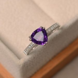 Shop Amethyst Engagement Rings! Natural amethyst ring, trillion cut ring, purple amethyst ring, engagement ring | Natural genuine Amethyst rings, simple unique alternative gemstone engagement rings. #rings #jewelry #bridal #wedding #jewelryaccessories #engagementrings #weddingideas #affiliate #ad
