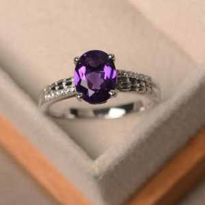 Shop Amethyst Engagement Rings! Purple amethyst ring, engagement ring, February birthstone, oval cut, sterling silver, bridal ring | Natural genuine Amethyst rings, simple unique alternative gemstone engagement rings. #rings #jewelry #bridal #wedding #jewelryaccessories #engagementrings #weddingideas #affiliate #ad