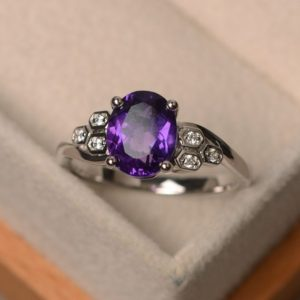 Shop Amethyst Engagement Rings! Purple amethyst ring, February birthstone, oval cut, sterling silver, engagement ring for women | Natural genuine Amethyst rings, simple unique alternative gemstone engagement rings. #rings #jewelry #bridal #wedding #jewelryaccessories #engagementrings #weddingideas #affiliate #ad
