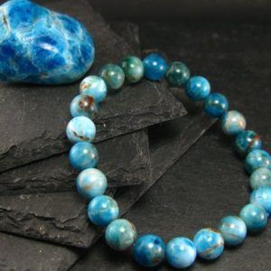 Shop Apatite Bracelets! Neon Blue Apatite Genuine Bracelet ~ 7 Inches  ~ 8mm Round Beads | Natural genuine Apatite bracelets. Buy crystal jewelry, handmade handcrafted artisan jewelry for women.  Unique handmade gift ideas. #jewelry #beadedbracelets #beadedjewelry #gift #shopping #handmadejewelry #fashion #style #product #bracelets #affiliate #ad