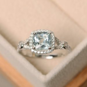 Shop Aquamarine Rings! Aquamarine ring, cushion cut, engagement ring, wedding ring, anniversary ring, March birthstone | Natural genuine Aquamarine rings, simple unique alternative gemstone engagement rings. #rings #jewelry #bridal #wedding #jewelryaccessories #engagementrings #weddingideas #affiliate #ad