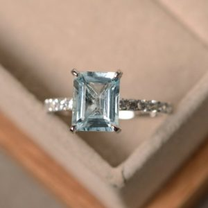 Shop Aquamarine Rings! Aquamarine engagement ring, sterling silver, emerald cut aquamarine, promise ring, March birthstone ring | Natural genuine Aquamarine rings, simple unique alternative gemstone engagement rings. #rings #jewelry #bridal #wedding #jewelryaccessories #engagementrings #weddingideas #affiliate #ad