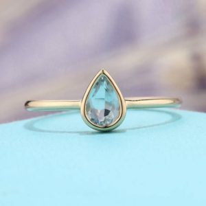 Shop Aquamarine Jewelry! Minimalist Pear shaped engagement ring Simple Aquamarine engagement ring bezel set 14K Gold Thin Dainty Petite Delicate Promise Anniversary | Natural genuine Aquamarine jewelry. Buy handcrafted artisan wedding jewelry.  Unique handmade bridal jewelry gift ideas. #jewelry #beadedjewelry #gift #crystaljewelry #shopping #handmadejewelry #wedding #bridal #jewelry #affiliate #ad
