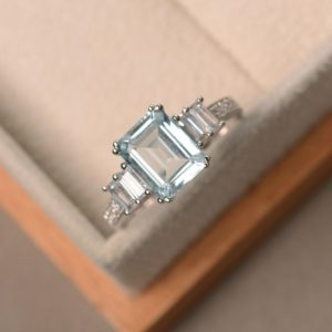 Natural aquamarine ring, blue gemstone, engagement ring, emerald cut, sterling silver | Natural genuine Array rings, simple unique alternative gemstone engagement rings. #rings #jewelry #bridal #wedding #jewelryaccessories #engagementrings #weddingideas #affiliate #ad