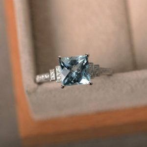 Aquamarine ring, square aquamarine, engagement ring, March birthstone, promise ring, sterling silver | Natural genuine Array rings, simple unique alternative gemstone engagement rings. #rings #jewelry #bridal #wedding #jewelryaccessories #engagementrings #weddingideas #affiliate #ad
