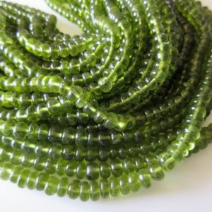 Beautiful Natural Rare Peridot Smooth Rondelle Beads, AAA Peridot, Wholesale gemstones, 6mm To 8mm Beads, 18 Inch Strand, SKU2767/1 | Natural genuine rondelle Peridot beads for beading and jewelry making.  #jewelry #beads #beadedjewelry #diyjewelry #jewelrymaking #beadstore #beading #affiliate #ad