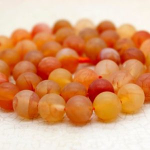 Shop Carnelian Round Beads! Matte Orange Carnelian Round Gemstone Beads (8mm 10mm) | Natural genuine round Carnelian beads for beading and jewelry making.  #jewelry #beads #beadedjewelry #diyjewelry #jewelrymaking #beadstore #beading #affiliate #ad
