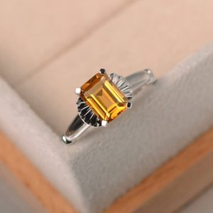 Shop Citrine Engagement Rings! emerald cut,solitaire ring,natural citrine ring,wedding ring,yellow gemstone ring,silver ring,November birthstone | Natural genuine Citrine rings, simple unique alternative gemstone engagement rings. #rings #jewelry #bridal #wedding #jewelryaccessories #engagementrings #weddingideas #affiliate #ad