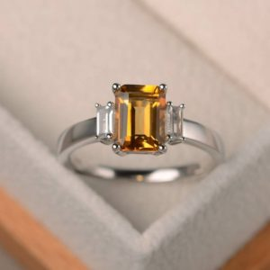 Shop Citrine Rings! Engagement ring, natural citrine ring, emerald cut yellow gemstone, November birthstone, sterling silver ring, three stones ring, | Natural genuine Citrine rings, simple unique alternative gemstone engagement rings. #rings #jewelry #bridal #wedding #jewelryaccessories #engagementrings #weddingideas #affiliate #ad