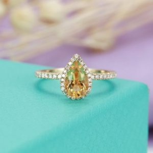 Shop Citrine Rings! Citrine engagement ring Pear shaped engagement ring for Women Halo Diamond Micro pave Half eternity Promise Unique Anniversary gift for her | Natural genuine Citrine rings, simple unique alternative gemstone engagement rings. #rings #jewelry #bridal #wedding #jewelryaccessories #engagementrings #weddingideas #affiliate #ad