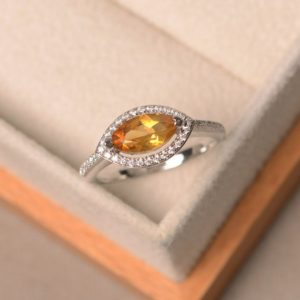 Shop Citrine Engagement Rings! Natural citrine ring, engagement ring, marquise cut yellow gemstone, sterling silver ring, halo ring | Natural genuine gemstone jewelry in modern, chic, boho, elegant styles. Buy crystal handmade handcrafted artisan art jewelry & accessories. #jewelry #beaded #beadedjewelry #product #gifts #shopping #style #fashion #product