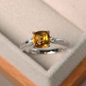 Shop Citrine Rings! Citrine ring, cushion cut, sterling silver, November birthstone ring, yellow gemstone engagement ring for women | Natural genuine Citrine rings, simple unique alternative gemstone engagement rings. #rings #jewelry #bridal #wedding #jewelryaccessories #engagementrings #weddingideas #affiliate #ad
