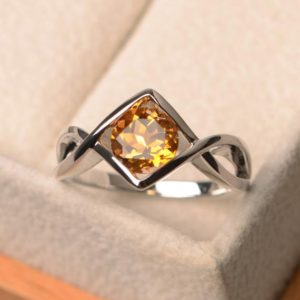 Shop Citrine Rings! Natural yellow citrine rings, engagement rings, round cut rings, sterling silver rings,November birthstone, solitaire ring | Natural genuine Citrine rings, simple unique alternative gemstone engagement rings. #rings #jewelry #bridal #wedding #jewelryaccessories #engagementrings #weddingideas #affiliate #ad