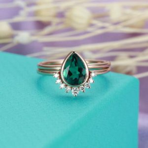 Shop Emerald Jewelry! Emerald Engagement Ring 14K gold Vintage Pear Shaped wedding ring Curved Diamond Bridal set jewelry Stacking Valentines day gift for women | Natural genuine Emerald jewelry. Buy handcrafted artisan wedding jewelry.  Unique handmade bridal jewelry gift ideas. #jewelry #beadedjewelry #gift #crystaljewelry #shopping #handmadejewelry #wedding #bridal #jewelry #affiliate #ad