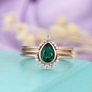Shop Emerald Engagement Rings! Pear Shaped Emerald Engagement Ring Set,curved wedding bands vintage moissanite/ Diamond Bridal  birthstone Stacking Anniversary | Natural genuine Emerald rings, simple unique alternative gemstone engagement rings. #rings #jewelry #bridal #wedding #jewelryaccessories #engagementrings #weddingideas #affiliate #ad
