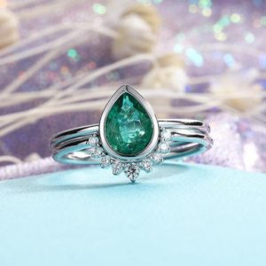 Shop Emerald Engagement Rings! Emerald Engagement Ring White gold Vintage Pear Shaped cut wedding  Curved Diamond Bridal set  birthstone Stacking Promise | Natural genuine Emerald rings, simple unique alternative gemstone engagement rings. #rings #jewelry #bridal #wedding #jewelryaccessories #engagementrings #weddingideas #affiliate #ad