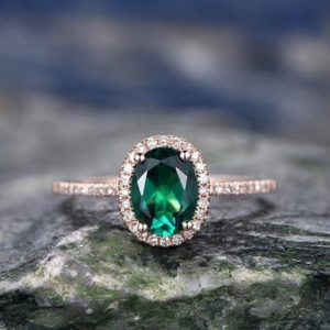 Shop Emerald Engagement Rings! Oval cut green emerald engagement ring Halo engagement ring rose gold handmade diamond ring May birthstone ring halo ring anniversary ring | Natural genuine Emerald rings, simple unique alternative gemstone engagement rings. #rings #jewelry #bridal #wedding #jewelryaccessories #engagementrings #weddingideas #affiliate #ad