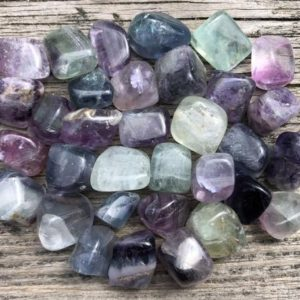 Shop Tumbled Fluorite Crystals & Pocket Stones! 1 / 4 Pound Rainbow Fluorite Tumbles / Quarter Lb Purple Blue Green Tumbled Stones | Natural genuine stones & crystals in various shapes & sizes. Buy raw cut, tumbled, or polished gemstones for making jewelry or crystal healing energy vibration raising reiki stones. #crystals #gemstones #crystalhealing #crystalsandgemstones #energyhealing #affiliate #ad