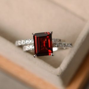 Shop Garnet Rings! Emerald cut garnet ring, sterling silver, engagement ring, January birthstone, red gemstone ring garnet | Natural genuine Garnet rings, simple unique alternative gemstone engagement rings. #rings #jewelry #bridal #wedding #jewelryaccessories #engagementrings #weddingideas #affiliate #ad