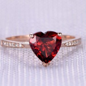 Shop Garnet Rings! Garnet Engagement Ring 14k Rose Gold 8mm Heart Shaped Stone Diamond Bridal Ring Wedding Band Personalized For her/him Custom Ring | Natural genuine Garnet rings, simple unique alternative gemstone engagement rings. #rings #jewelry #bridal #wedding #jewelryaccessories #engagementrings #weddingideas #affiliate #ad