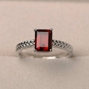 Engagement ring, natural garnet ring, emerald cut red gemstone, January birthstone, solitaire ring, sterling silver ring | Natural genuine Array rings, simple unique alternative gemstone engagement rings. #rings #jewelry #bridal #wedding #jewelryaccessories #engagementrings #weddingideas #affiliate #ad