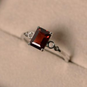 Shop Garnet Rings! Garnet Engagement Rings, Emerald Cut, January Birthstone, Promise Ring, Sterling Silver 925, Solitaire Rings | Natural genuine Garnet rings, simple unique alternative gemstone engagement rings. #rings #jewelry #bridal #wedding #jewelryaccessories #engagementrings #weddingideas #affiliate #ad