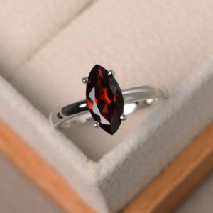 Shop Garnet Rings! Natural garnet ring, wedding ring, red gemstone, solitaire ring, January birthstone ring, marquise cut gemstone | Natural genuine Garnet rings, simple unique alternative gemstone engagement rings. #rings #jewelry #bridal #wedding #jewelryaccessories #engagementrings #weddingideas #affiliate #ad
