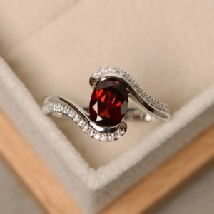 Garnet ring, oval cut garnet, engagement ring, natural garnet, January birthstone, ring garnet | Natural genuine Gemstone rings, simple unique alternative gemstone engagement rings. #rings #jewelry #bridal #wedding #jewelryaccessories #engagementrings #weddingideas #affiliate #ad