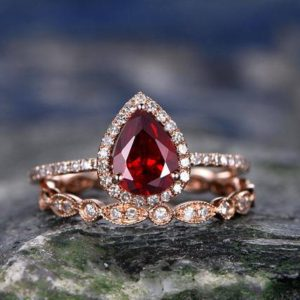 Shop Garnet Rings! Red Garnet engagement ring-Solid 14k rose gold- Diamond Bridal ring Set-Stacking band-6x8mm Pear shaped cut gemstone promise ring for her | Natural genuine Garnet rings, simple unique alternative gemstone engagement rings. #rings #jewelry #bridal #wedding #jewelryaccessories #engagementrings #weddingideas #affiliate #ad