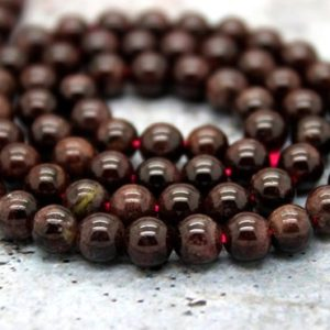 Shop Garnet Round Beads! Garnet Smooth Round Ball Sphere Gemstone Loose Beads Natural Stone (3mm 4mm 5mm 6mm 7mm 8mm 10mm) | Natural genuine round Garnet beads for beading and jewelry making.  #jewelry #beads #beadedjewelry #diyjewelry #jewelrymaking #beadstore #beading #affiliate #ad