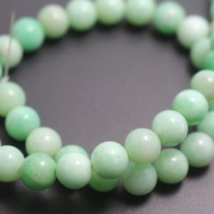 14mm Green Jade Beads,Dyed Candy Jade Beads,Smooth and Round  Beads,15 inches one starand | Natural genuine round Jade beads for beading and jewelry making.  #jewelry #beads #beadedjewelry #diyjewelry #jewelrymaking #beadstore #beading #affiliate #ad