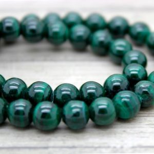 Shop Malachite Round Beads! Malachite Round Ball Smooth Sphere Beads Natural Stone Loose Gemstone | Natural genuine round Malachite beads for beading and jewelry making.  #jewelry #beads #beadedjewelry #diyjewelry #jewelrymaking #beadstore #beading #affiliate #ad