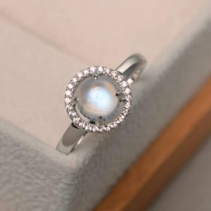 Shop Moonstone Engagement Rings! Natural blue moonstone rings, unique engagement rings, June birthstone, round cut rings, halo rings | Natural genuine Moonstone rings, simple unique alternative gemstone engagement rings. #rings #jewelry #bridal #wedding #jewelryaccessories #engagementrings #weddingideas #affiliate #ad