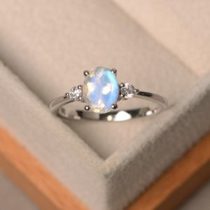 Shop Moonstone Engagement Rings! Natural blue moonstone rings, engagement rings, June birthstone, oval cut rings, sterling silver ring | Natural genuine Moonstone rings, simple unique alternative gemstone engagement rings. #rings #jewelry #bridal #wedding #jewelryaccessories #engagementrings #weddingideas #affiliate #ad