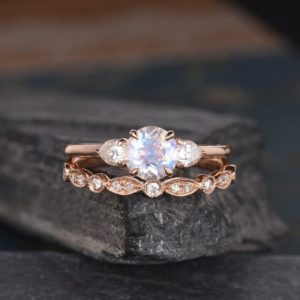 Shop Moonstone Engagement Rings! Rose Gold Moonstone Engagement Ring Bridal Set Moissanite Three Stone Diamond Band Wedding Pear Shaped Half Eternity Promise Women Art Deco | Natural genuine Moonstone rings, simple unique alternative gemstone engagement rings. #rings #jewelry #bridal #wedding #jewelryaccessories #engagementrings #weddingideas #affiliate #ad
