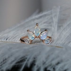 Shop Moonstone Rings! Moonstone wedding band Rose gold Women Curved Marquise cut Pear shaped Matching Jewelry Anniversary gift for her Unique Promise Prong set | Natural genuine Moonstone rings, simple unique alternative gemstone engagement rings. #rings #jewelry #bridal #wedding #jewelryaccessories #engagementrings #weddingideas #affiliate #ad