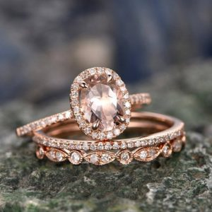 Shop Morganite Jewelry! 3pcs 6x8mm oval pink morganite engagement ring set solid 14k rose gold ring matching wedding set halo diamond anniversary bridal ring set | Natural genuine Morganite jewelry. Buy handcrafted artisan wedding jewelry.  Unique handmade bridal jewelry gift ideas. #jewelry #beadedjewelry #gift #crystaljewelry #shopping #handmadejewelry #wedding #bridal #jewelry #affiliate #ad