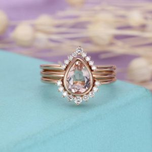 Shop Morganite Jewelry! 3pcs Morganite Engagement Ring Vintage Rose Gold Diamond Wedding band Women Antique Bridal set Jewelry Pear Shaped Stacking Anniversary gift | Natural genuine Morganite jewelry. Buy handcrafted artisan wedding jewelry.  Unique handmade bridal jewelry gift ideas. #jewelry #beadedjewelry #gift #crystaljewelry #shopping #handmadejewelry #wedding #bridal #jewelry #affiliate #ad