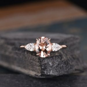 Oval Cut Morganite Engagement Ring Rose Gold Pear Shaped Moissanite Three Stone Bridal Wedding Women Antique Ring Anniversary Gift For Her | Natural genuine Gemstone rings, simple unique alternative gemstone engagement rings. #rings #jewelry #bridal #wedding #jewelryaccessories #engagementrings #weddingideas #affiliate #ad