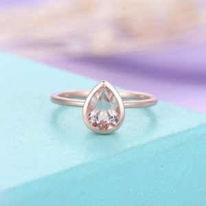 Shop Morganite Jewelry! Pear Shaped Cut Engagement Ring Rose Gold Morganite Ring Simple Wedding women Bridal Jewelry Delicate Stacking Anniversary personalized | Natural genuine Morganite jewelry. Buy handcrafted artisan wedding jewelry.  Unique handmade bridal jewelry gift ideas. #jewelry #beadedjewelry #gift #crystaljewelry #shopping #handmadejewelry #wedding #bridal #jewelry #affiliate #ad