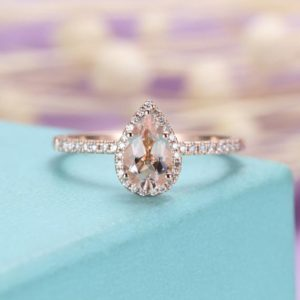 Shop Morganite Jewelry! Pear shaped engagement ring Rose gold Morganite engagement ring Women Wedding Halo diamond Anniversary gift for her Bridal set Half eternity | Natural genuine Morganite jewelry. Buy handcrafted artisan wedding jewelry.  Unique handmade bridal jewelry gift ideas. #jewelry #beadedjewelry #gift #crystaljewelry #shopping #handmadejewelry #wedding #bridal #jewelry #affiliate #ad
